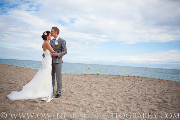 Bride and groom beach wedding photo