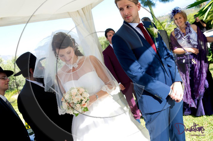 bride circling groom at jewish wedding ceremony in Spain