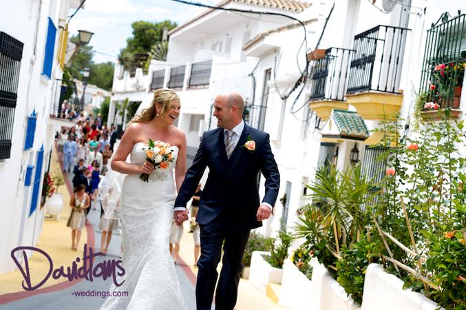 bridal party walking through the streets of Benalmadena