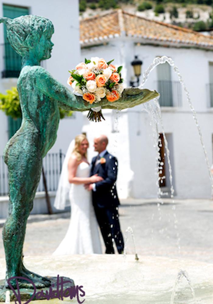 Bride and groom at wedding venue in Spain