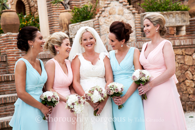 Bride with bridesmaids at her wedding in Spain