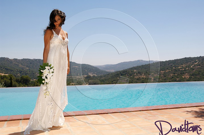 bride photographed in her dress at her wedding in Spain