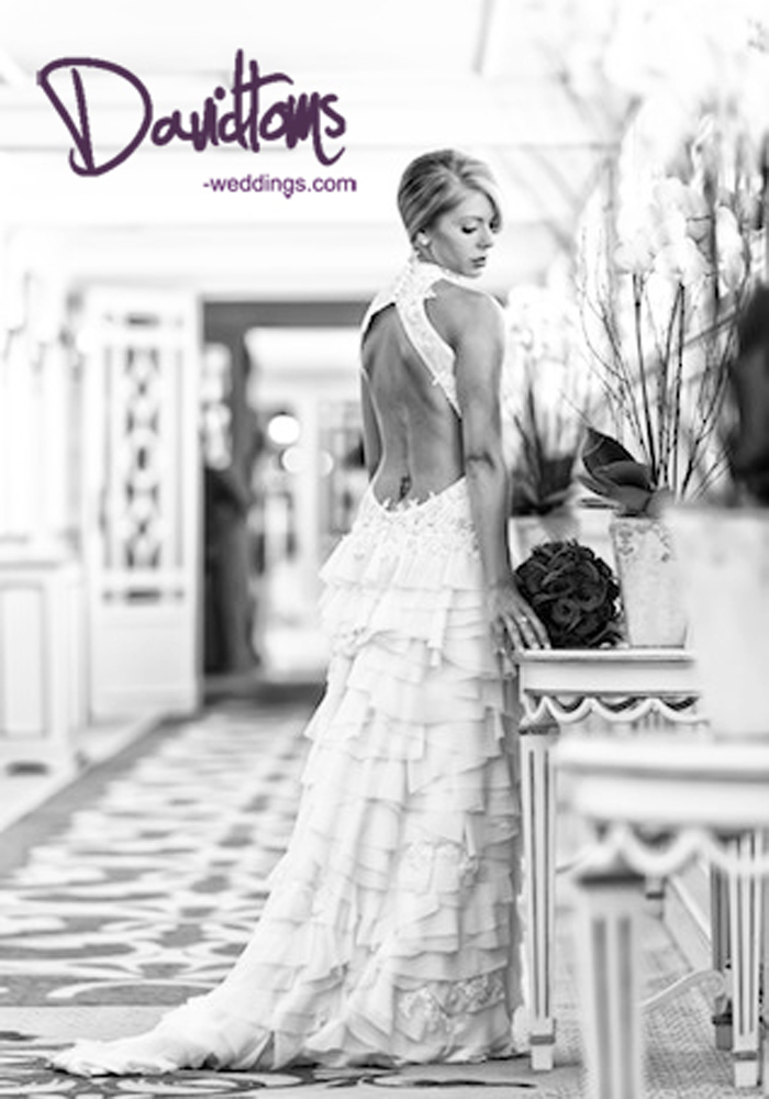 Brides stunning bridal gown at her wedding venue in Spain