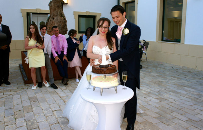 bride and groom cutting their wedding cake in Spain
