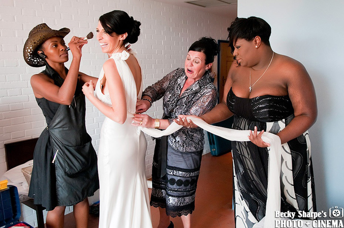 Brides-maid-help-bride-get-ready-for-her-wedding-in-Spain
