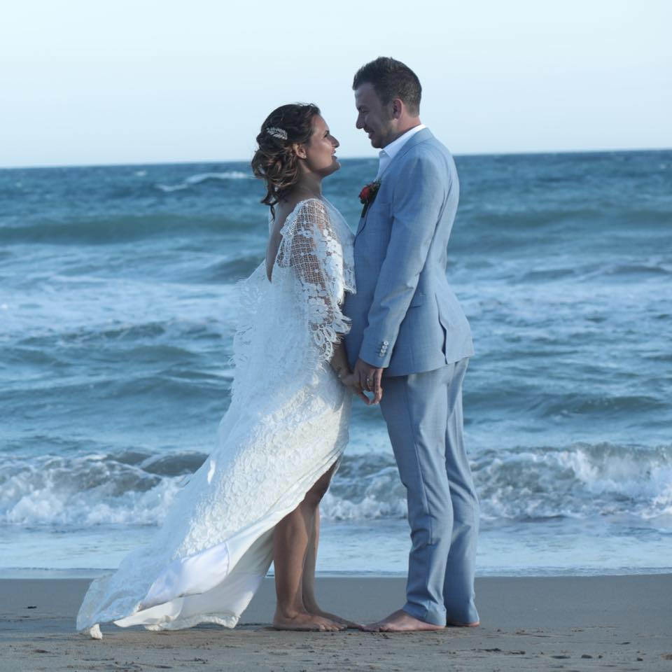 Bridal couple on beach in Spain
