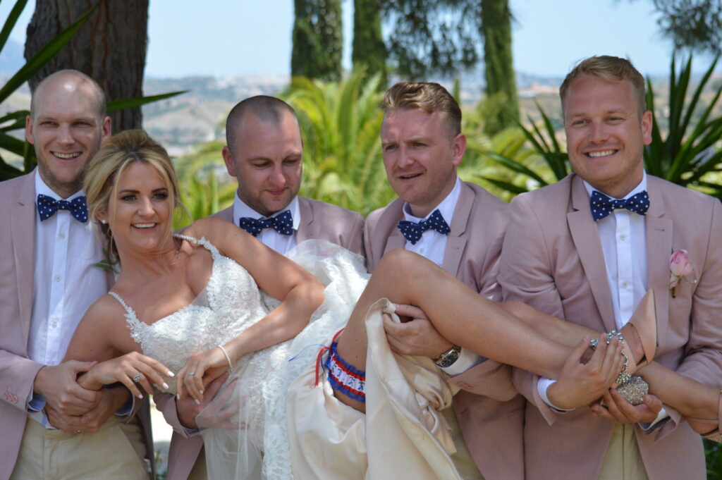 The bride is lifted by her groom and other male members of the bridal party!