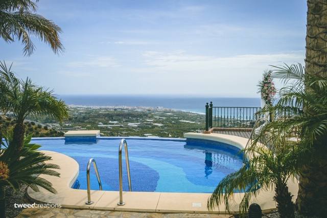 The tranquil villa pool and sea view