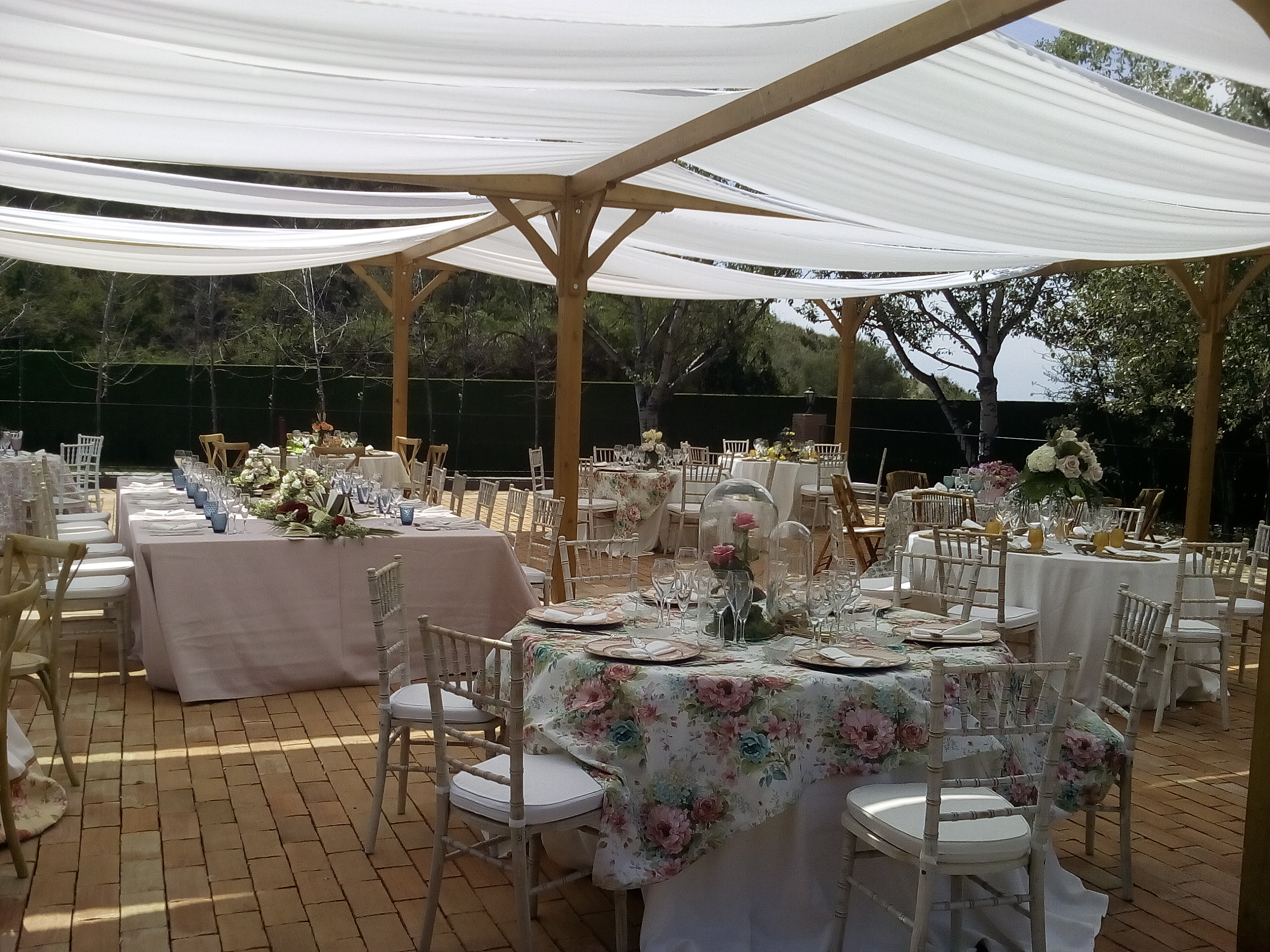 Luxury drapes frame fairy-tale wedding decor in the unique gardens