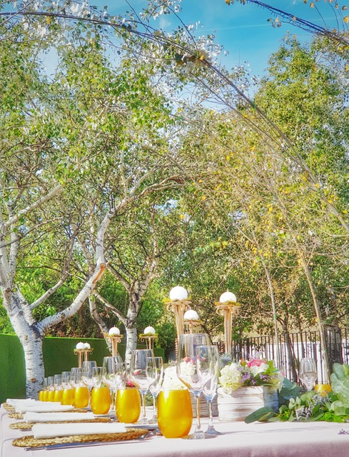 A picturesque backdrop of trees enhancing the magical table setting