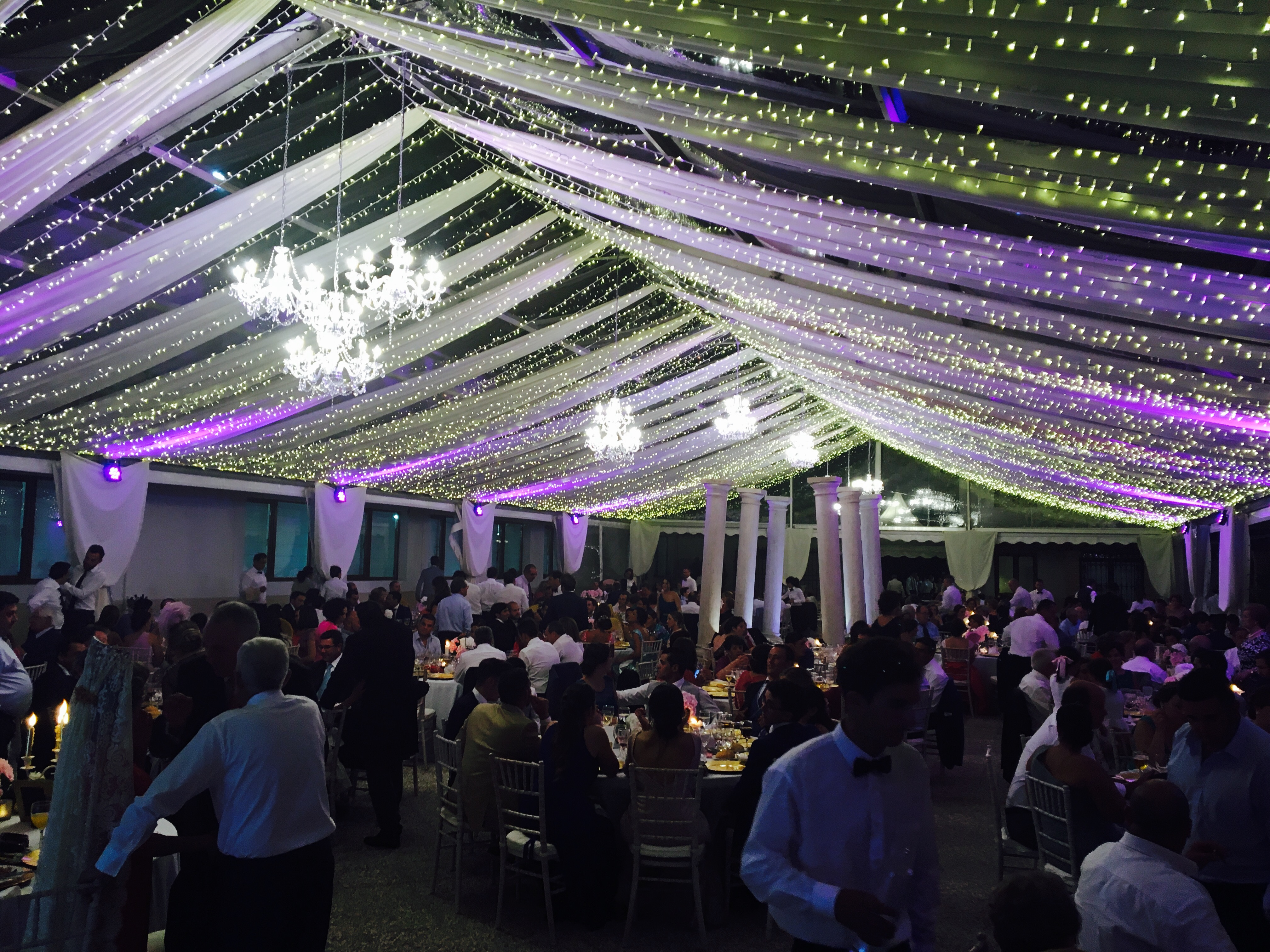Fairy lights and chandeliers create a magical backdrop for evening celebrations