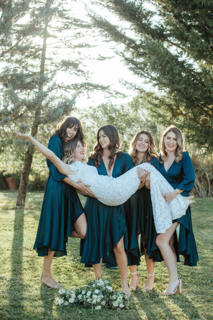 The bride being lifted by her bridesmaids! - photo by @simon_gorges