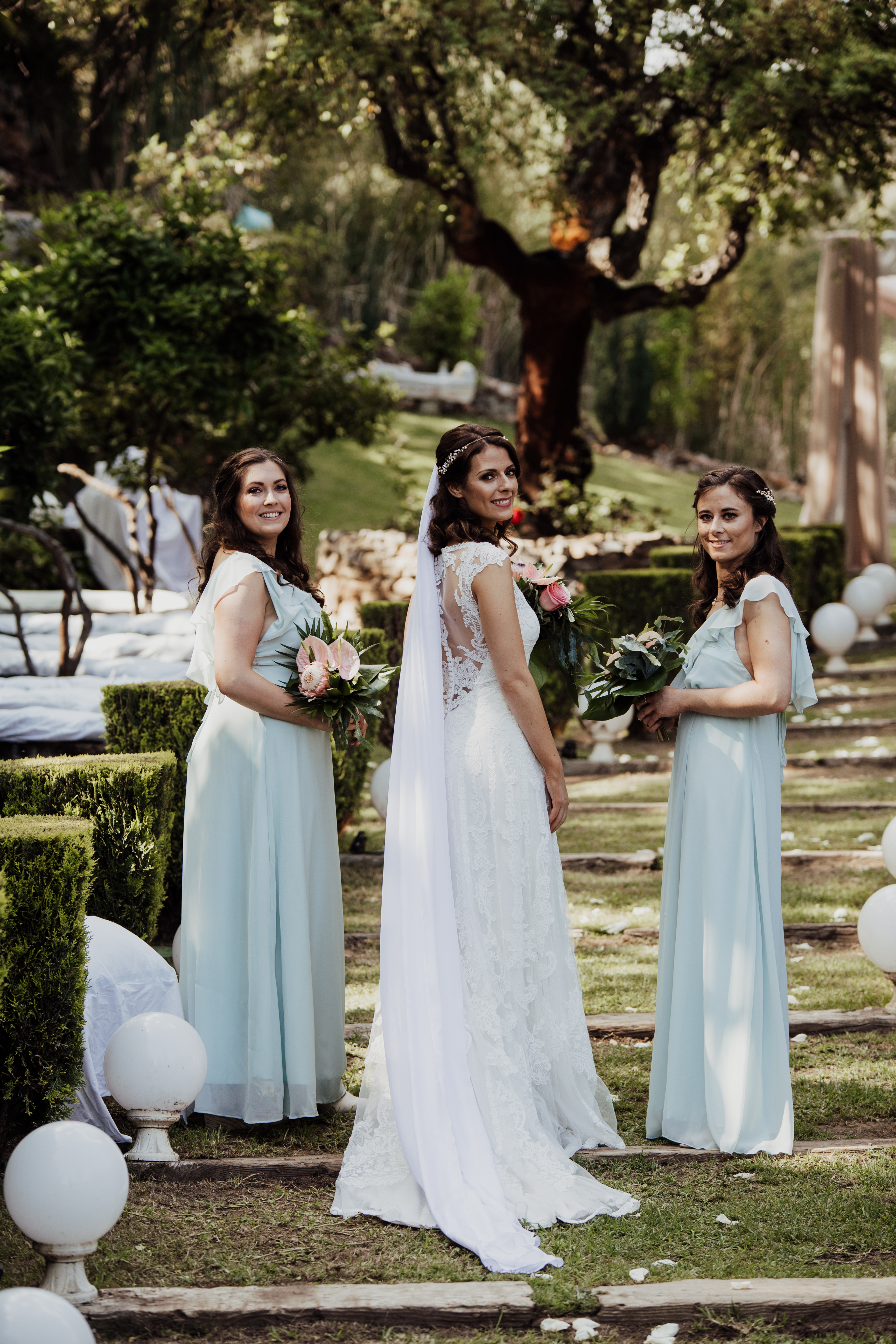 The beautiful bride and her bridesmaids in the unique villa gardens