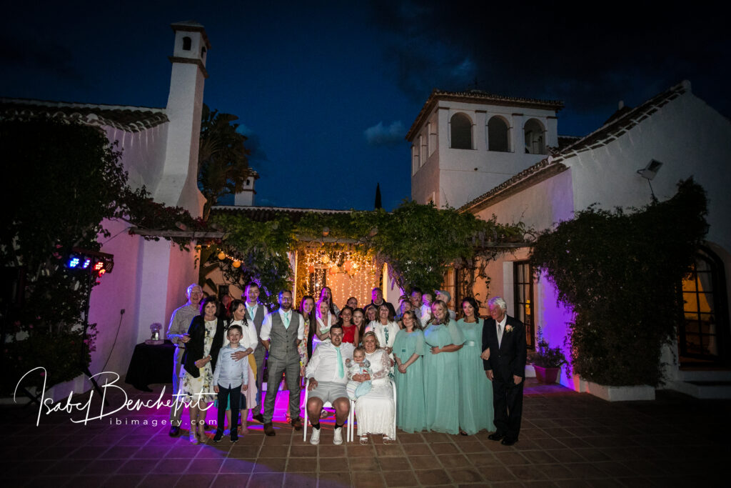 Bridal party by night outside the wedding Hecienda