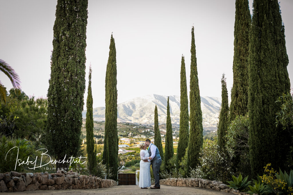 Bride and groom in the luxurious gardens of the Hacienda