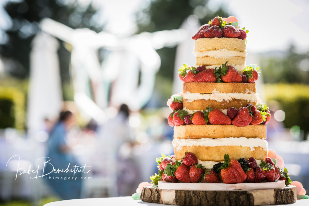 The glorious strawberry-studded naked layer wedding cake