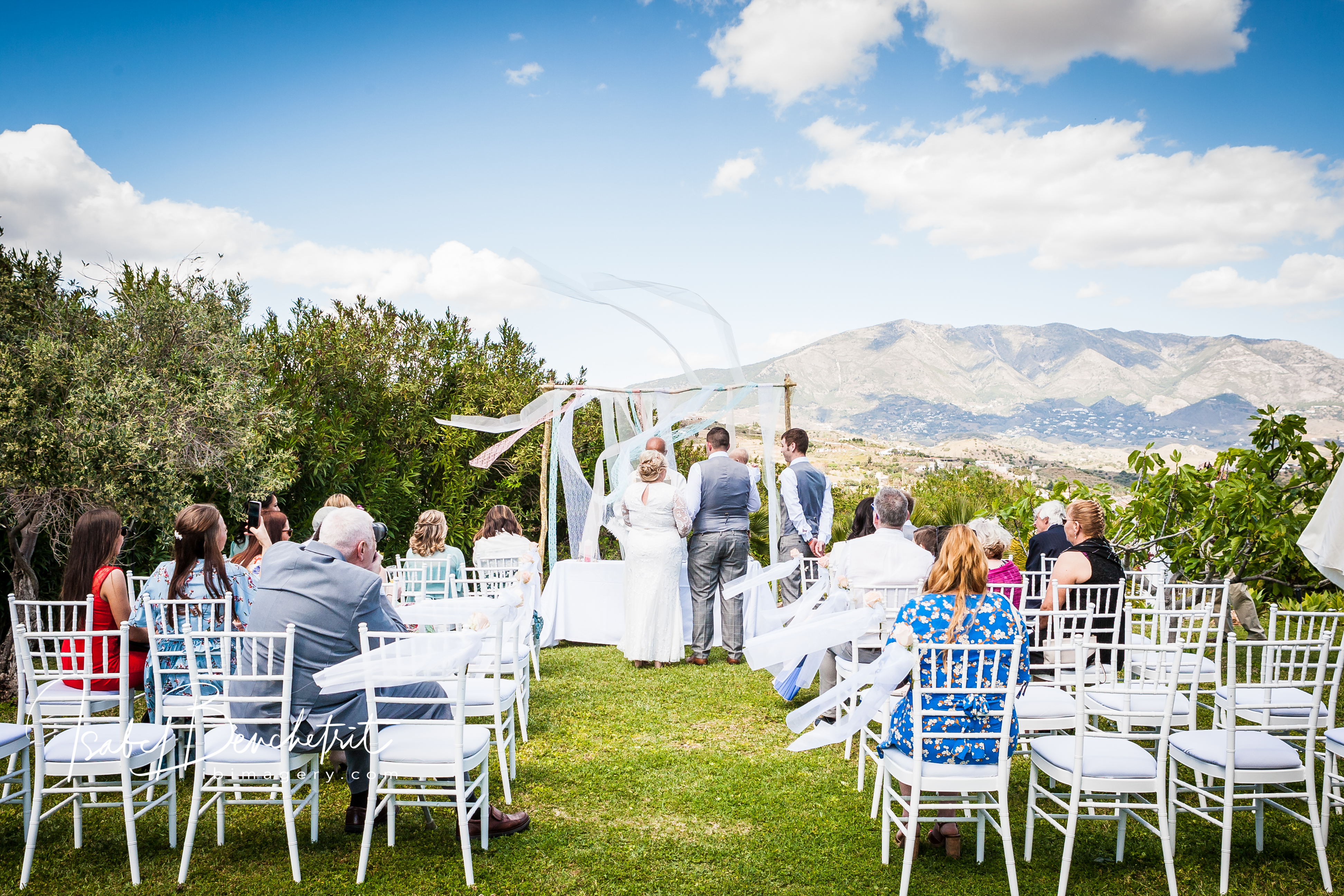 The wedding ceremony in the Hacienda gardens amidst a stunning mountain backdrop