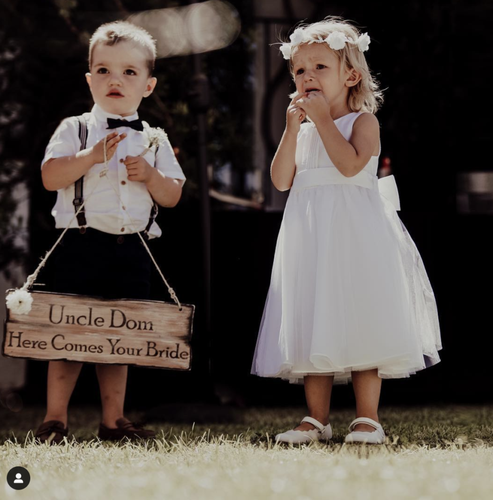 Two Children Dressed For A Wedding