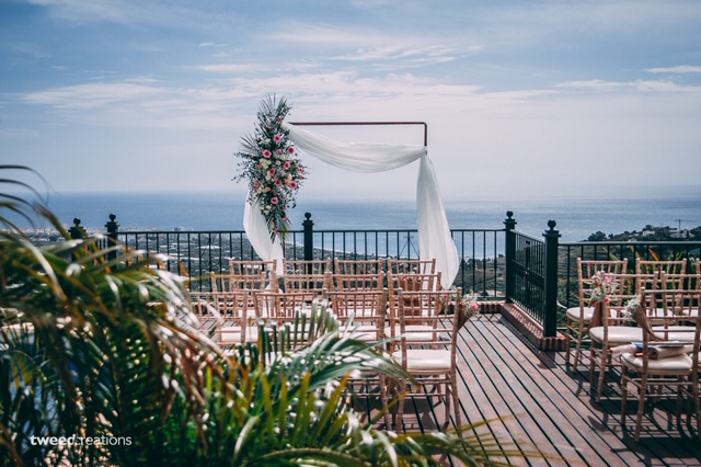 Wedding ceremony decor and panoramic Mediterranean view