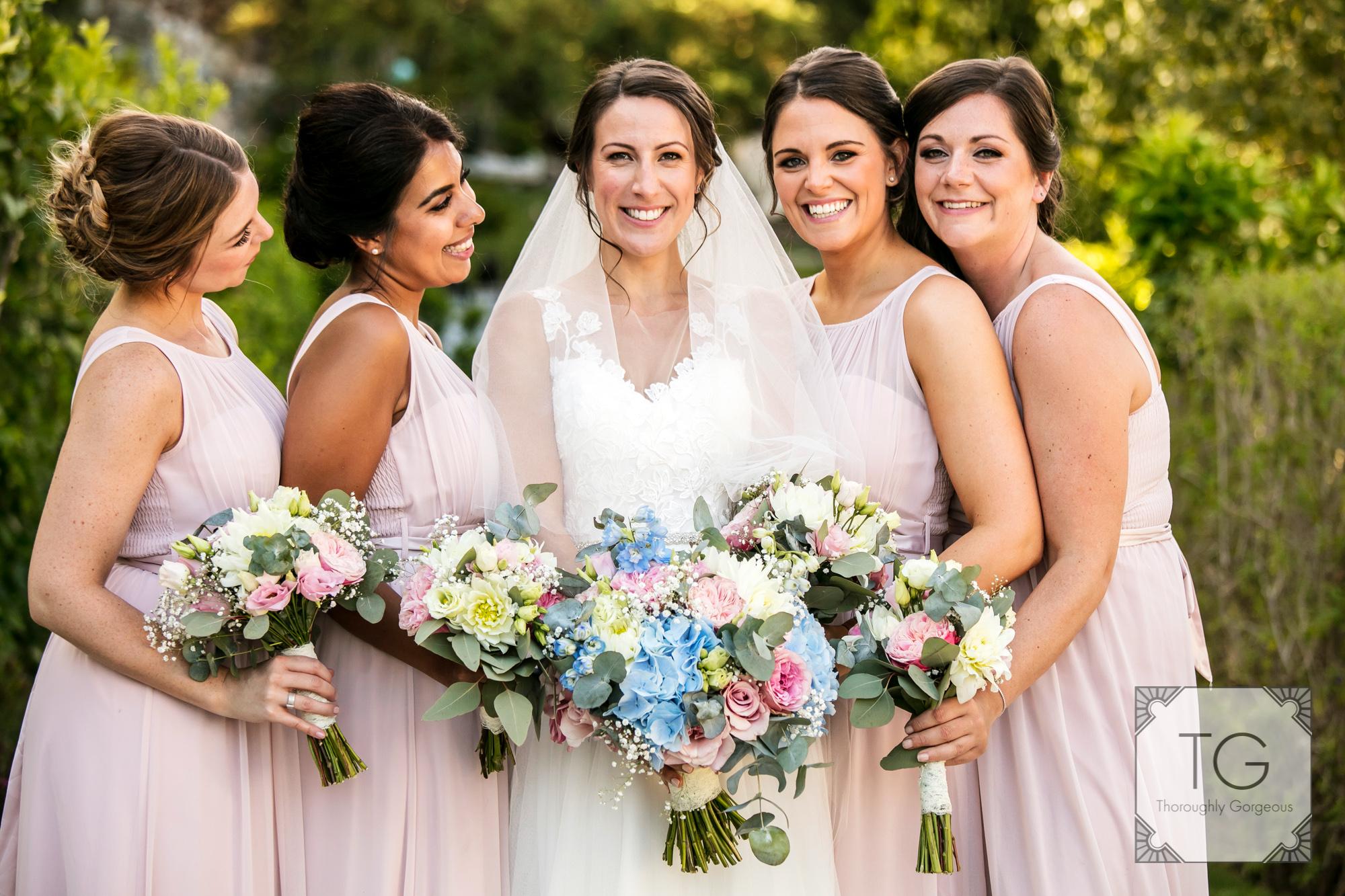 Bride an bridesmaids at a villa wedding