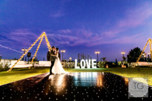 Bride and groom on a stunning LED dance floor