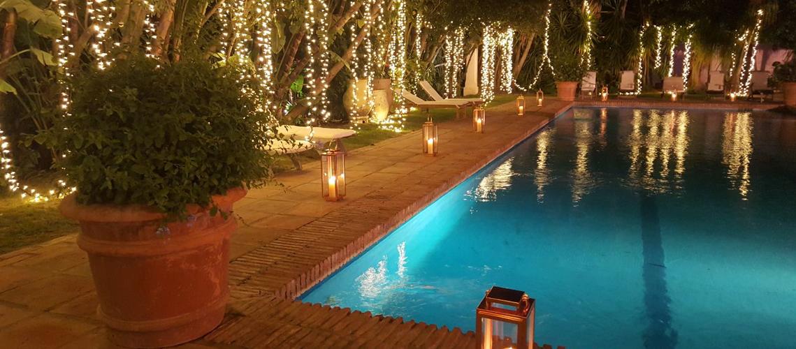 El Molino's magical pool area by night