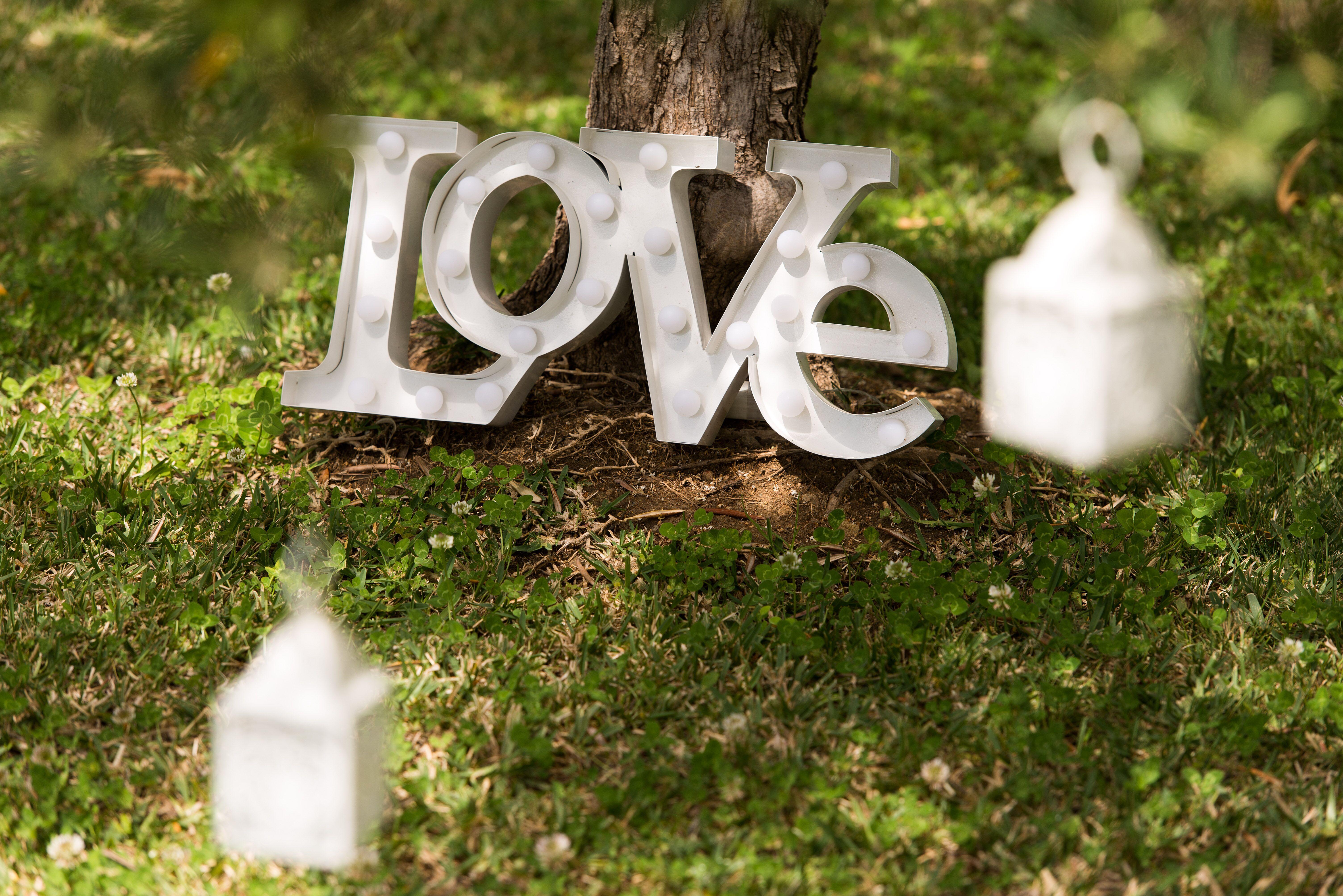 Illuminated words and lanterns make perfect wedding decor