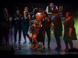Gillian on stage with a gospel choir