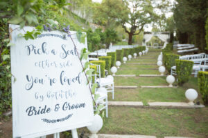 Wedding welcome board in the gardens of a Marbella wedding venue