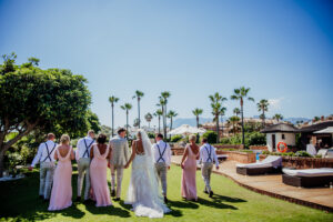 The bridal party in the lush green grounds of the villa