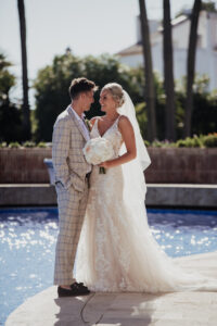 Bride and groom taking a quiet moment by the pool