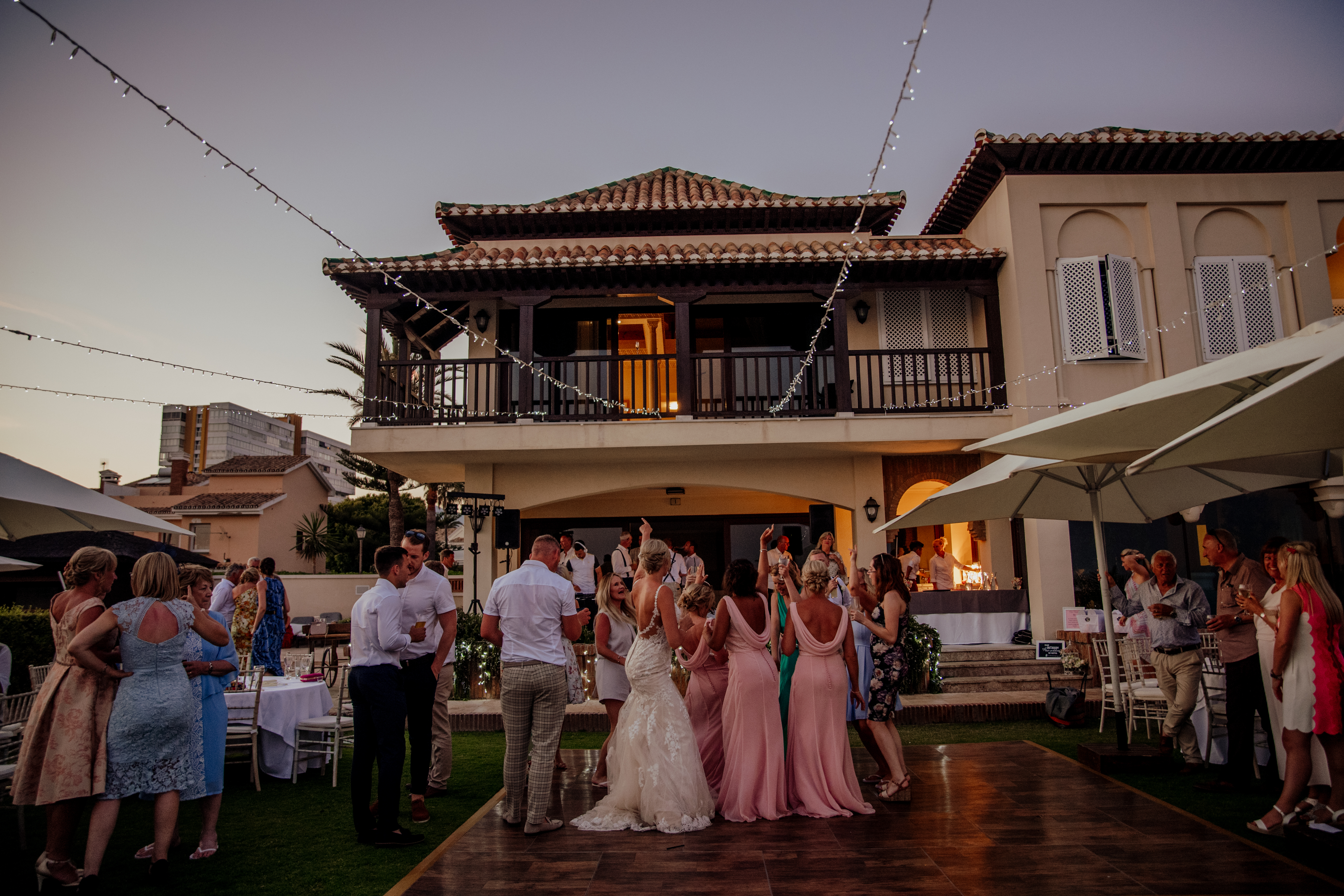 Guests on the dance floor in the villa's gardens
