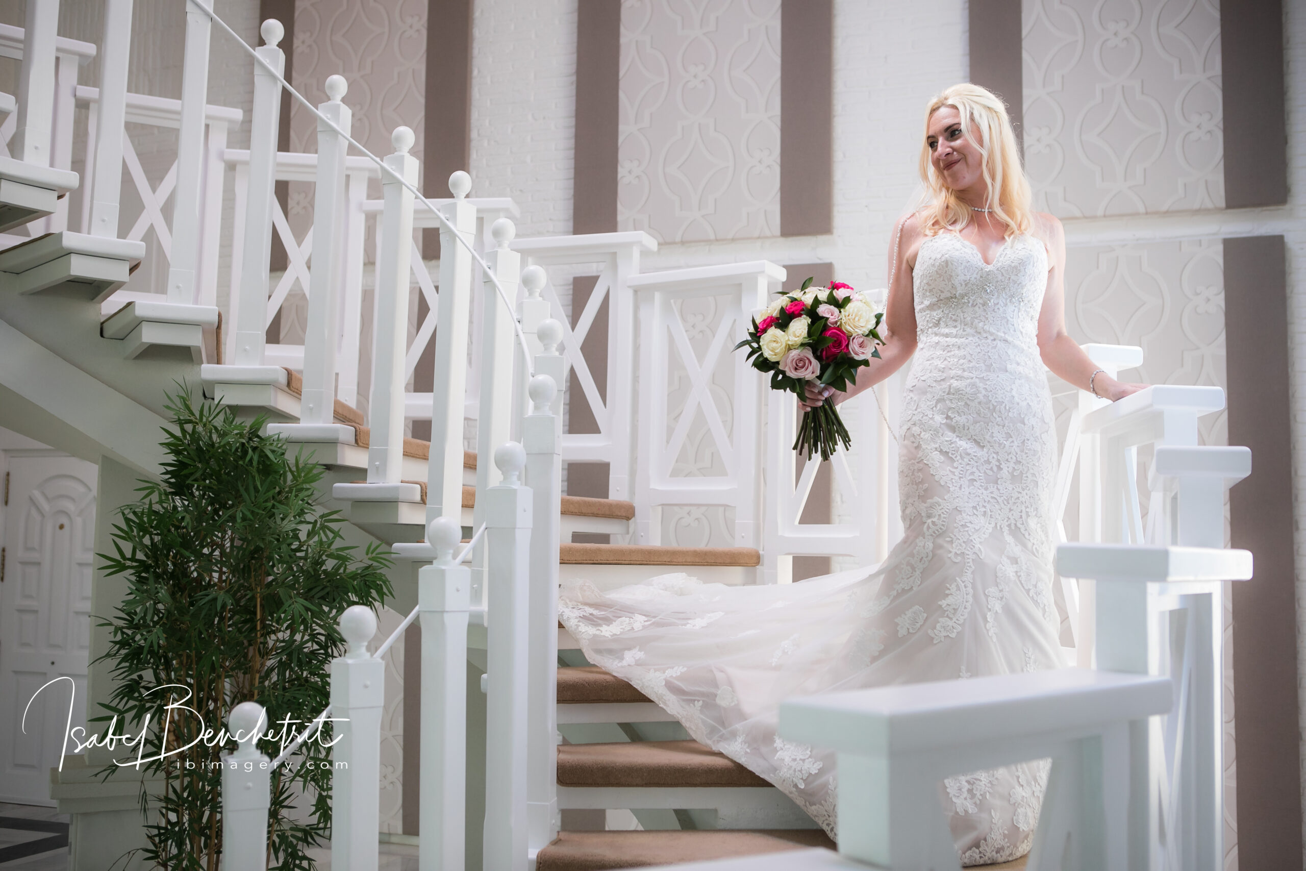 The beautiful bride on the villa's magnificent staircase