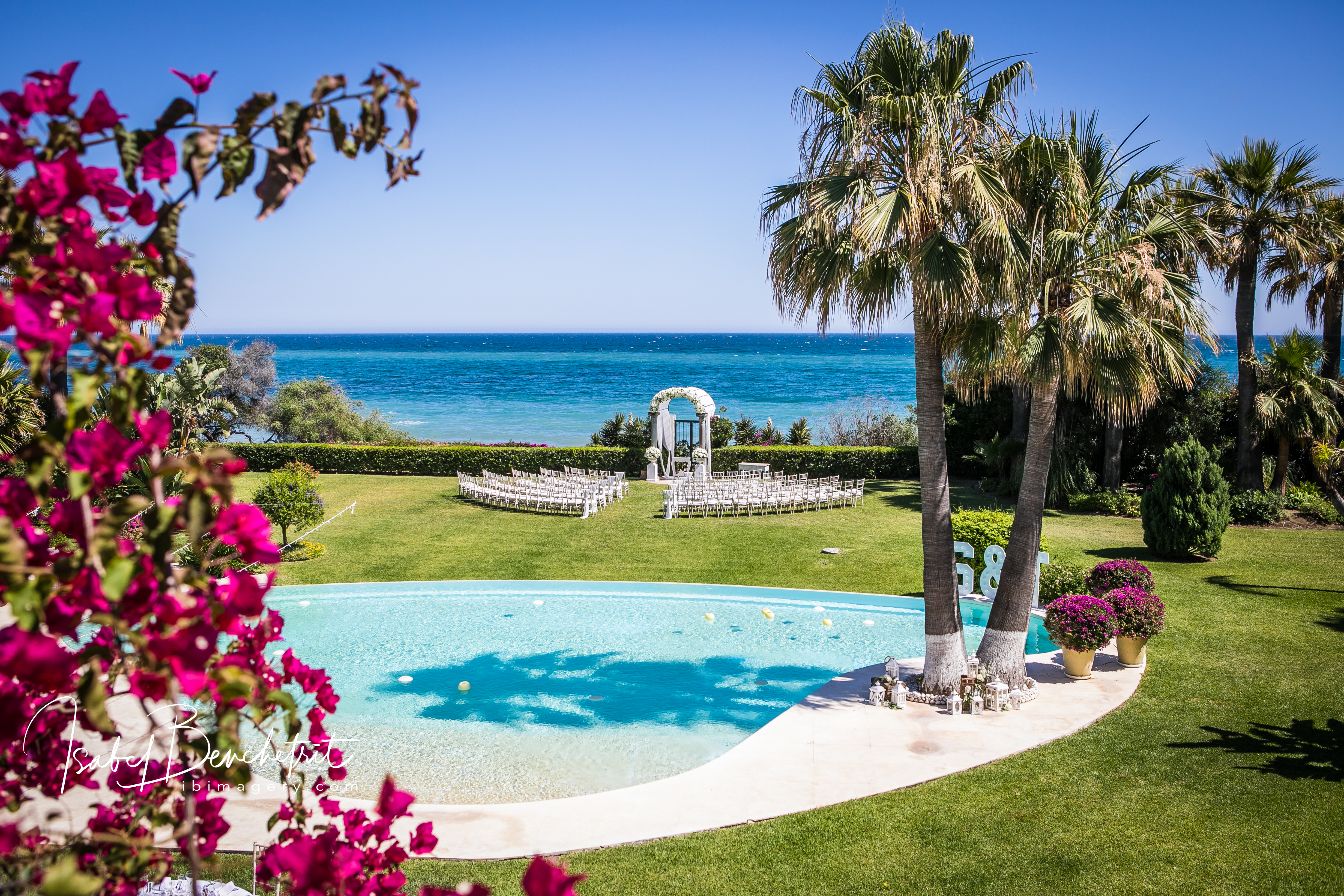 Villa gardens, pool, ceremony set up and stunning sea view