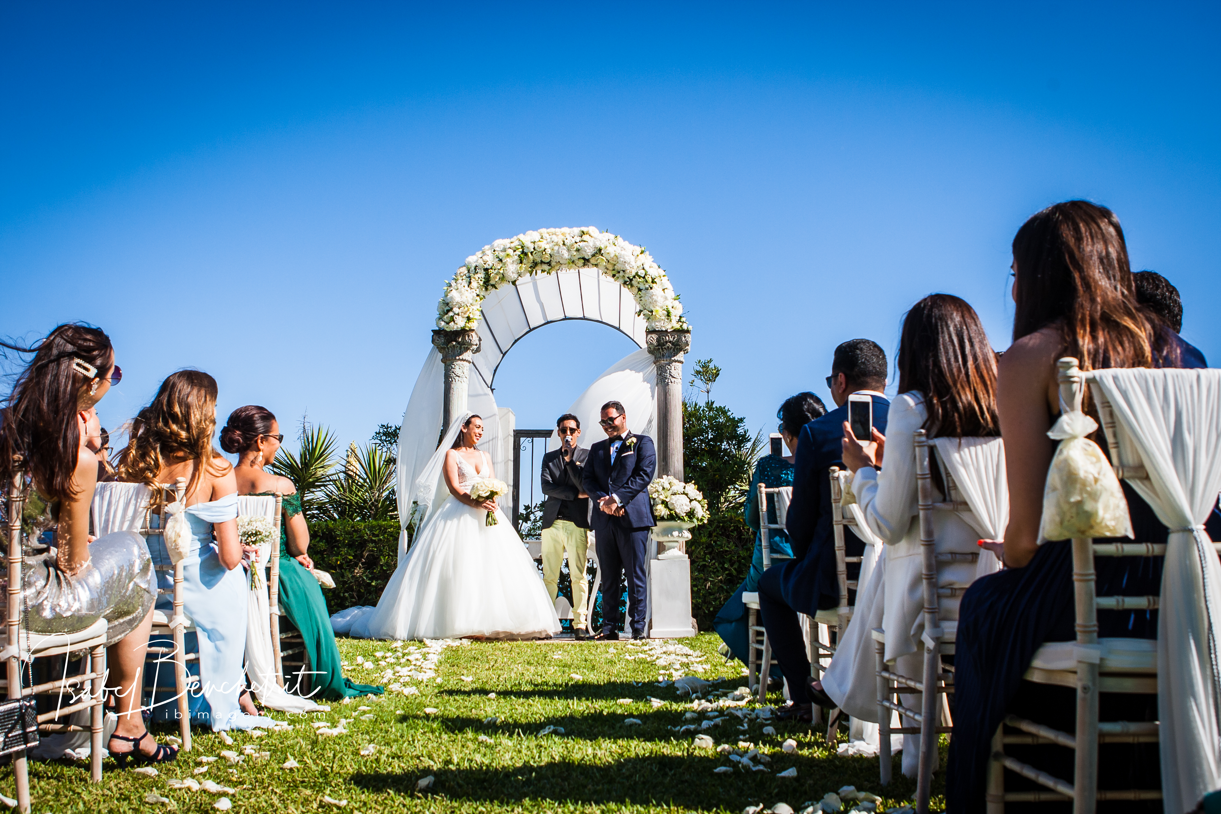 The wedding ceremony in the lush green gardens