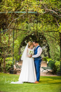 The bride and groom in the stunning gardens