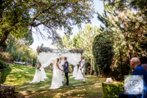 The wedding ceremony in the beautiful finca gardens