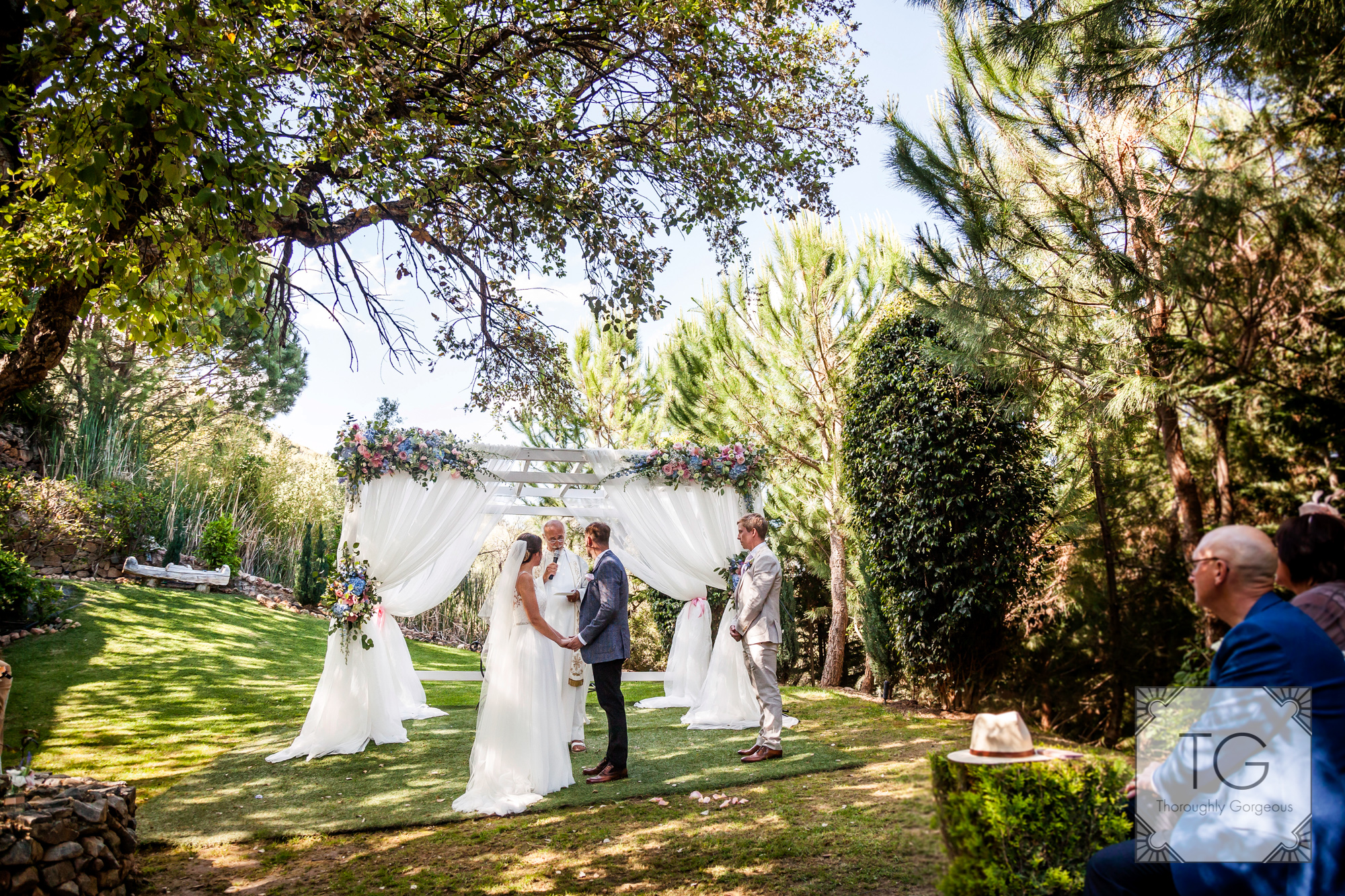 The wedding ceremony in the beautiful finca gardens