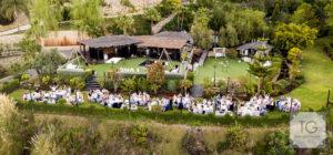 Guests dining al fresco in the finca's gardens