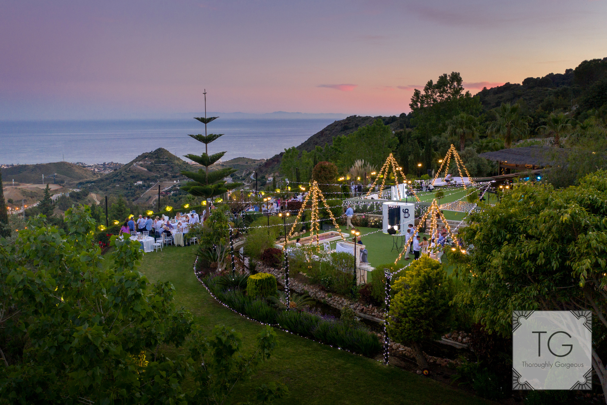The Finca and its fairy-lights at dusk