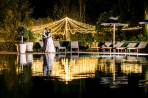 The bride and groom under the Finca's fairy lights - Talia Giraudo, Thoroughly Gorgeous