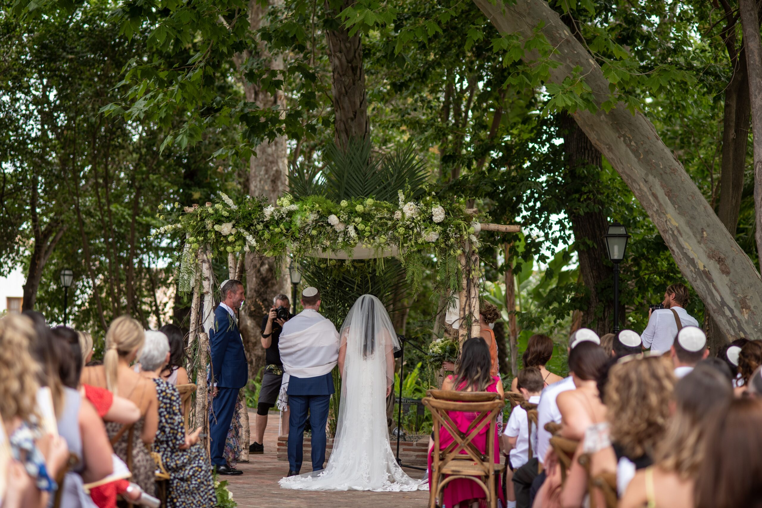 The bride and groom exchanging vows in the grounds of the Hacienda - Jeremy Standley Photographer