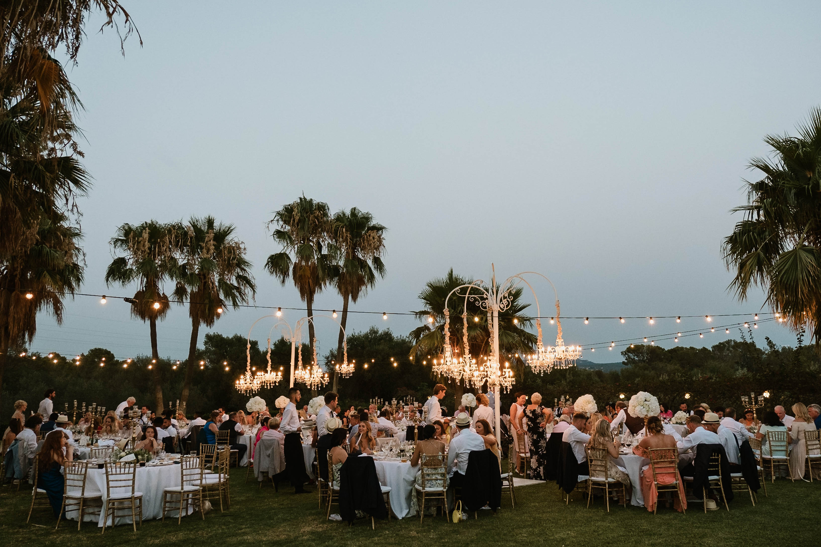 Illuminations in the gardens as the sun sets on the bridal party