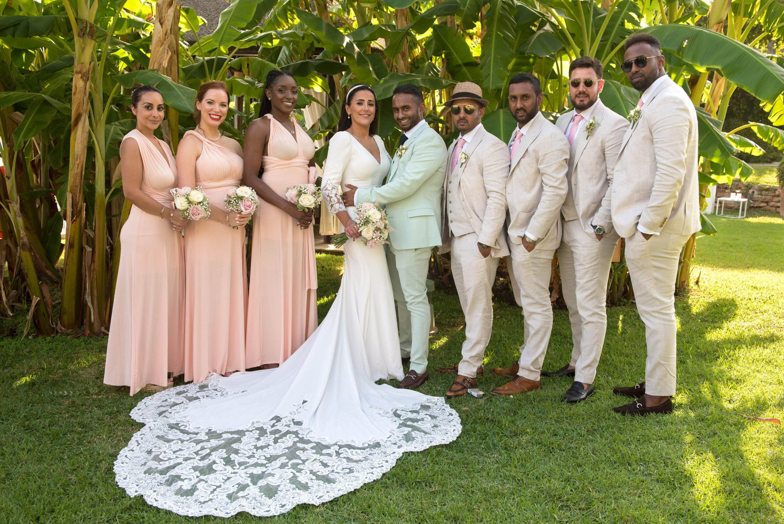 The bride and groom with their bridesmaids and attendants