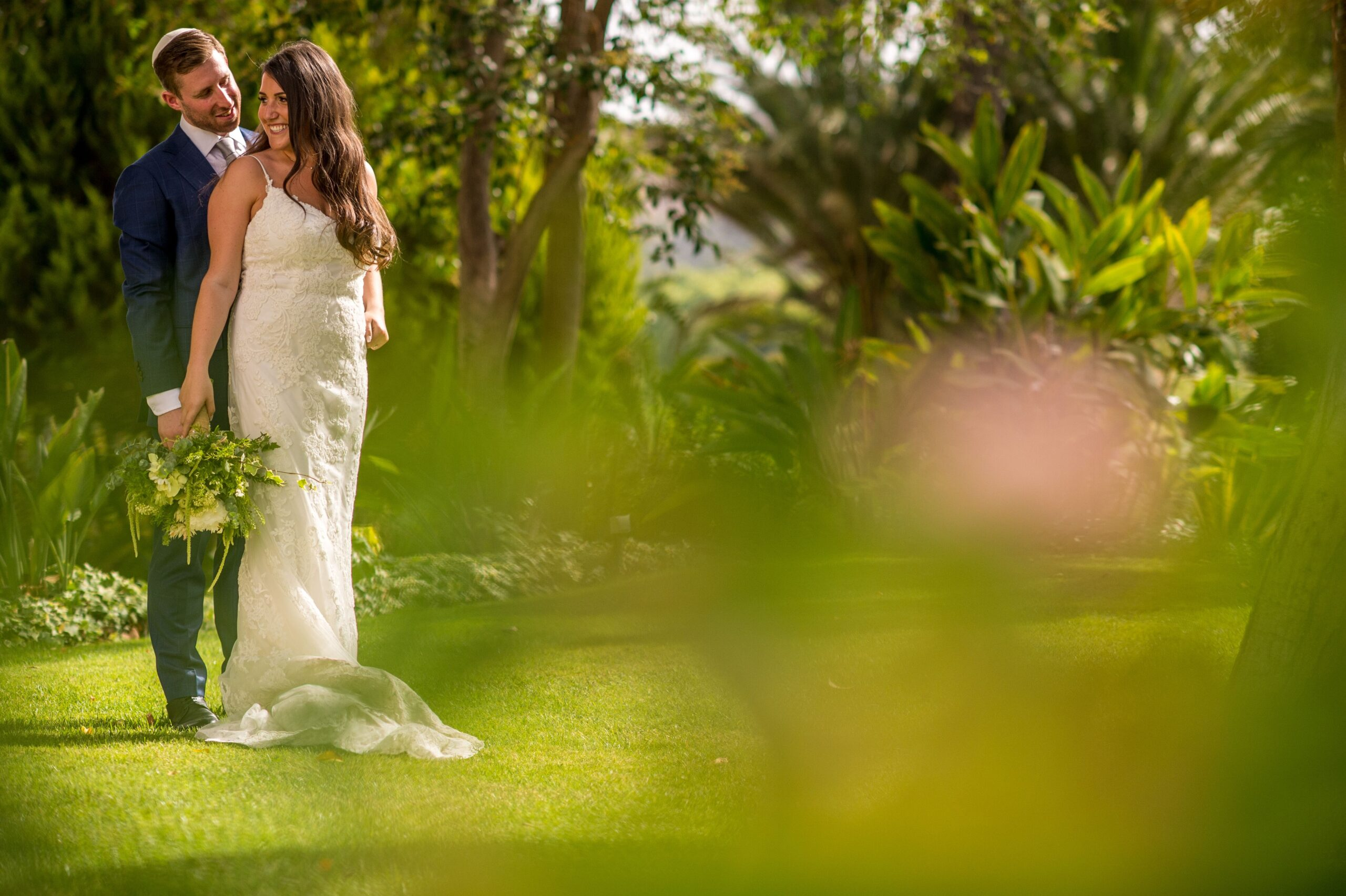 The bride and groom in the lush grounds of the Haceinda - Jeremy Standley Photographer