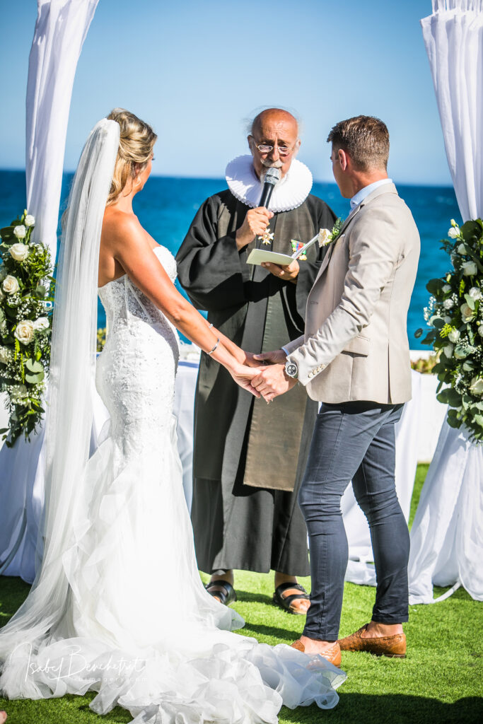 The bride and groom exchanging wedding vows