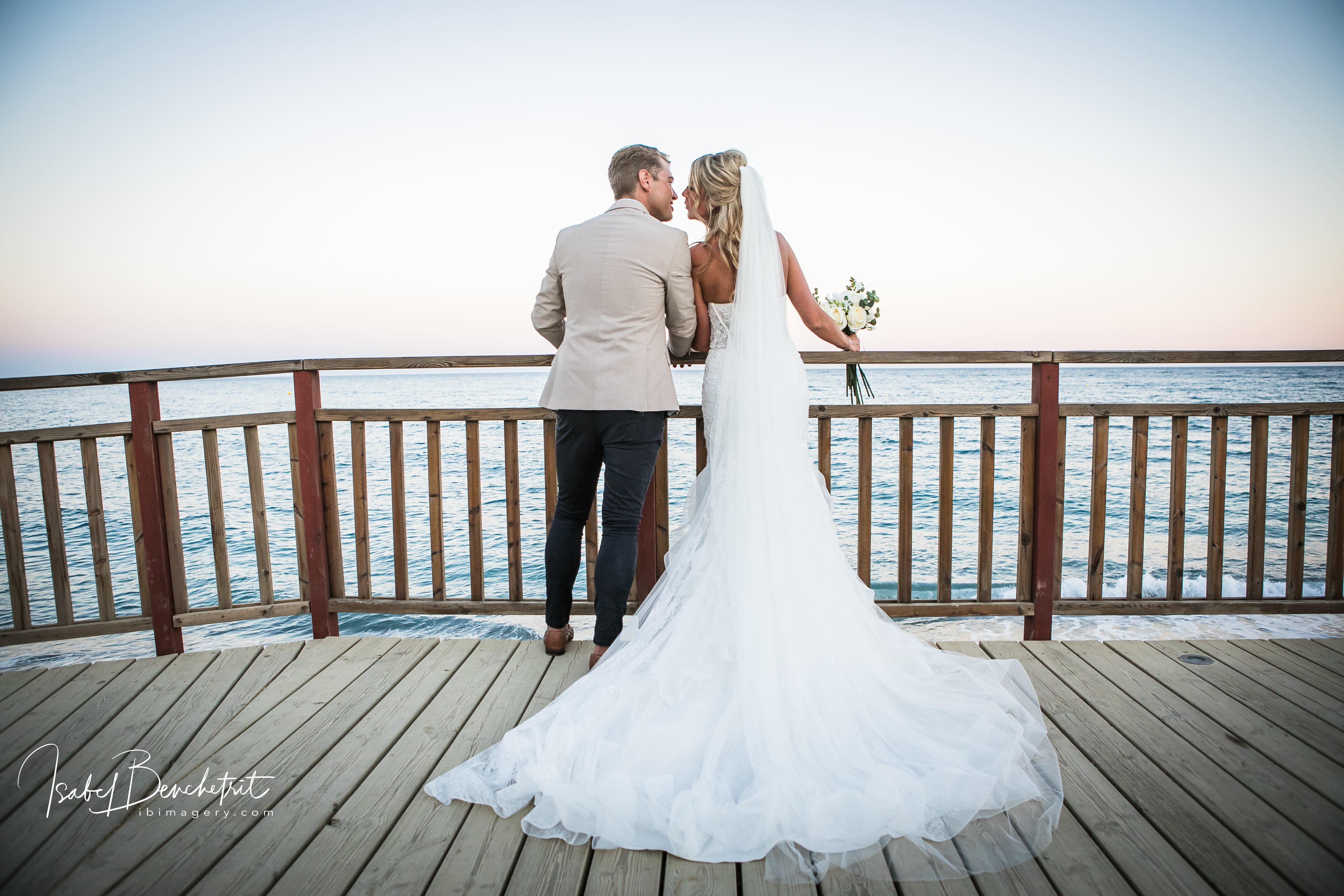 The bride and groom enjoying the seascape on the beach club's jetty