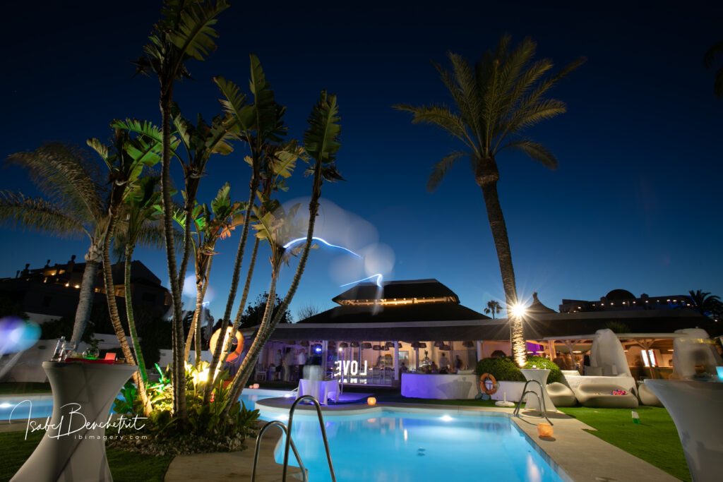 The sparkly lights of the beach club at night