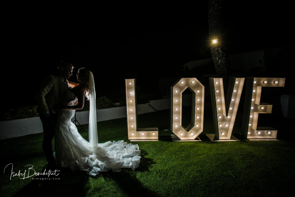 Bride and groom in the beautifully illuminated gardens
