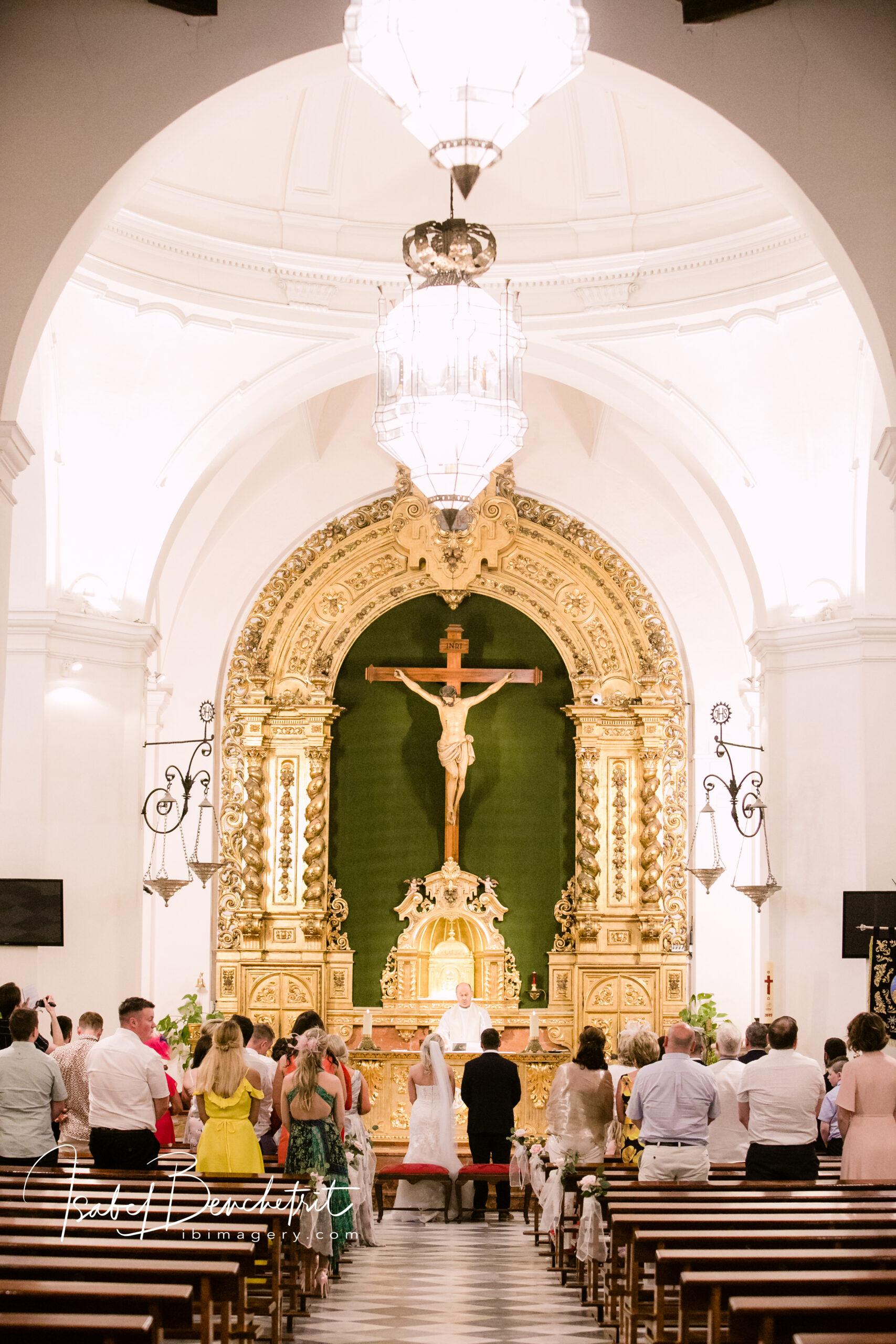 The wedding ceremony inside the beautiful church near the venue